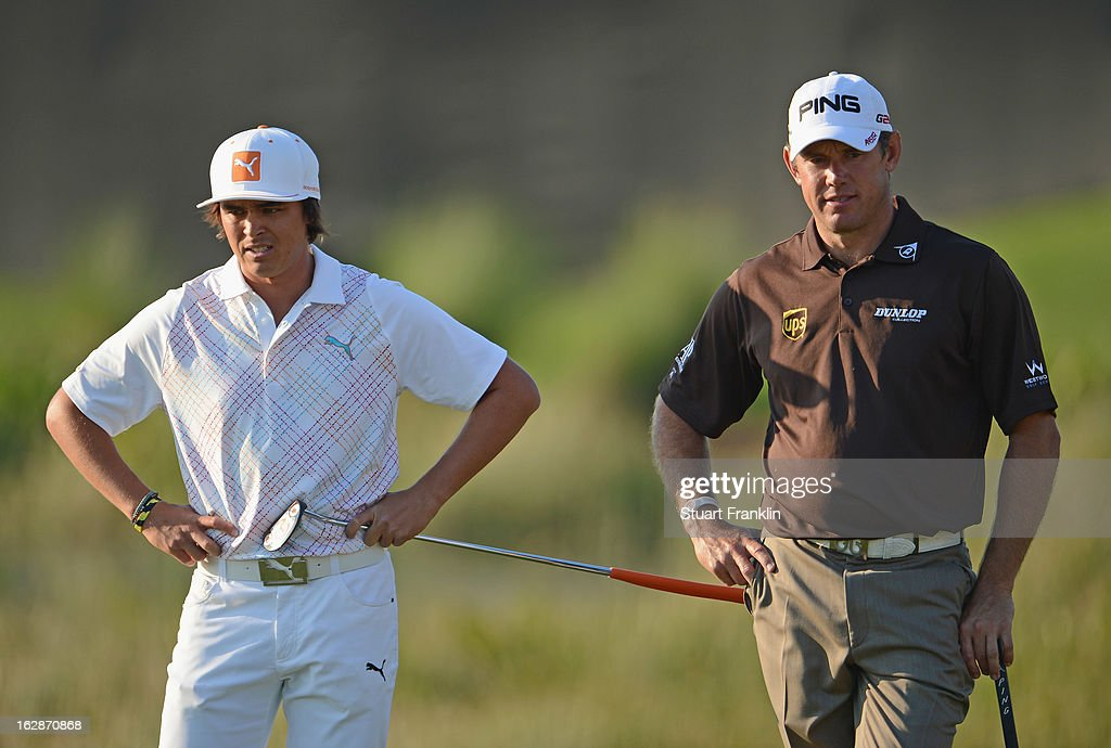 Rickie Fowler of USA and Lee Westwood of England ponder during the first round of the Honda Classic on February 28, 2013 in Palm Beach Gardens, Florida.