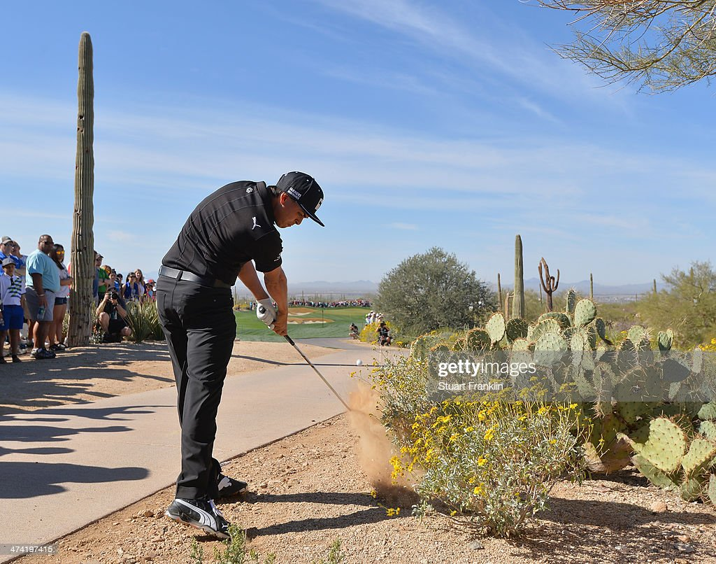 Rickie Fowler of USA plays a shot on the second hole during the quarterfinal round of the World Golf Championships - Accenture Match Play Championship at The Golf Club at Dove Mountain on February 22, 2014 in Marana, Arizona.