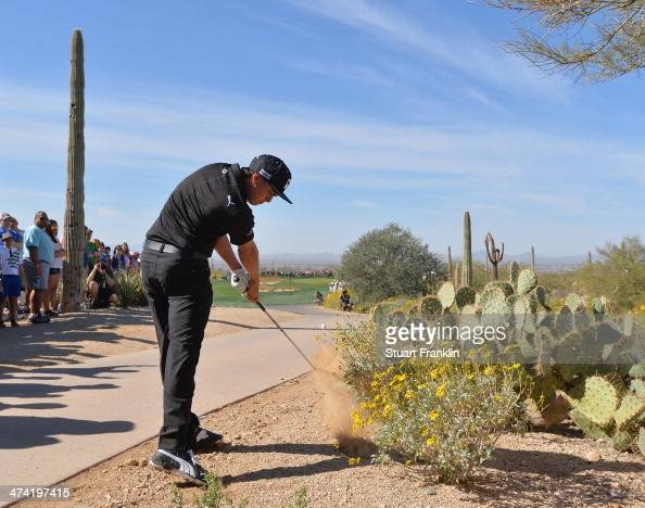 Rickie Fowler of USA plays a shot on the second hole during the quarterfinal round of the World Golf Championships Accenture Match Play Championship...