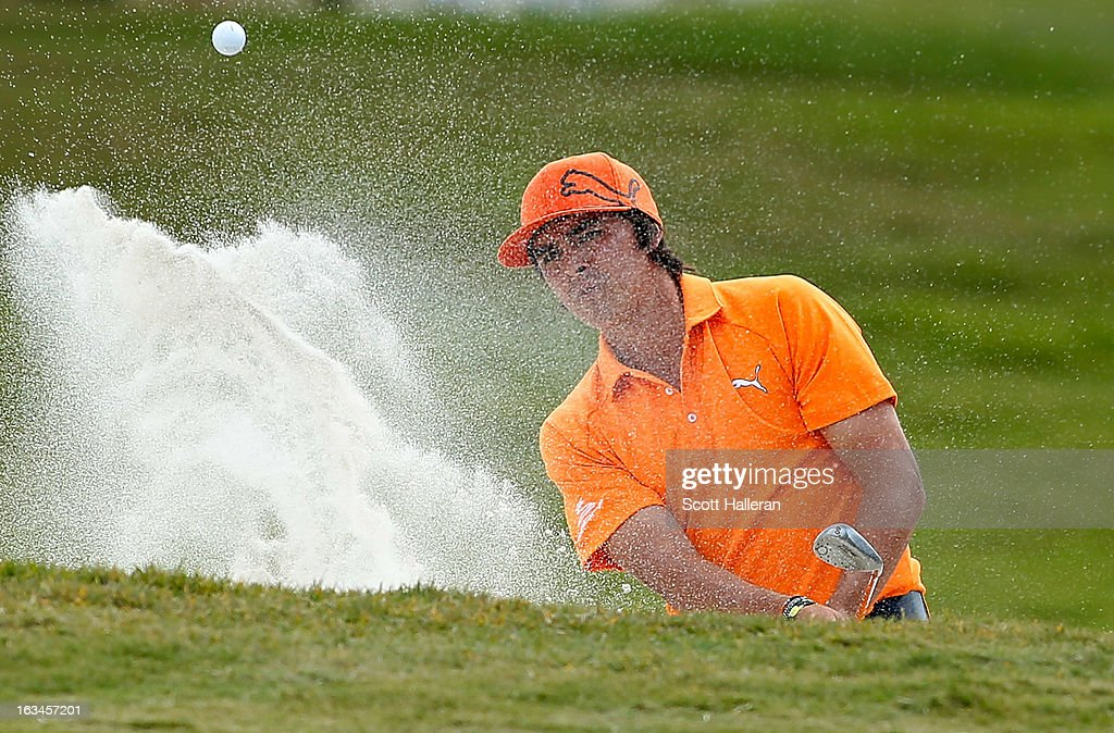 Rickie Fowler plays a bunker shot on the first hole during the final round of the World Golf Championships-Cadillac Championship at the Trump Doral Golf Resort & Spa on March 10, 2013 in Doral, Florida.
