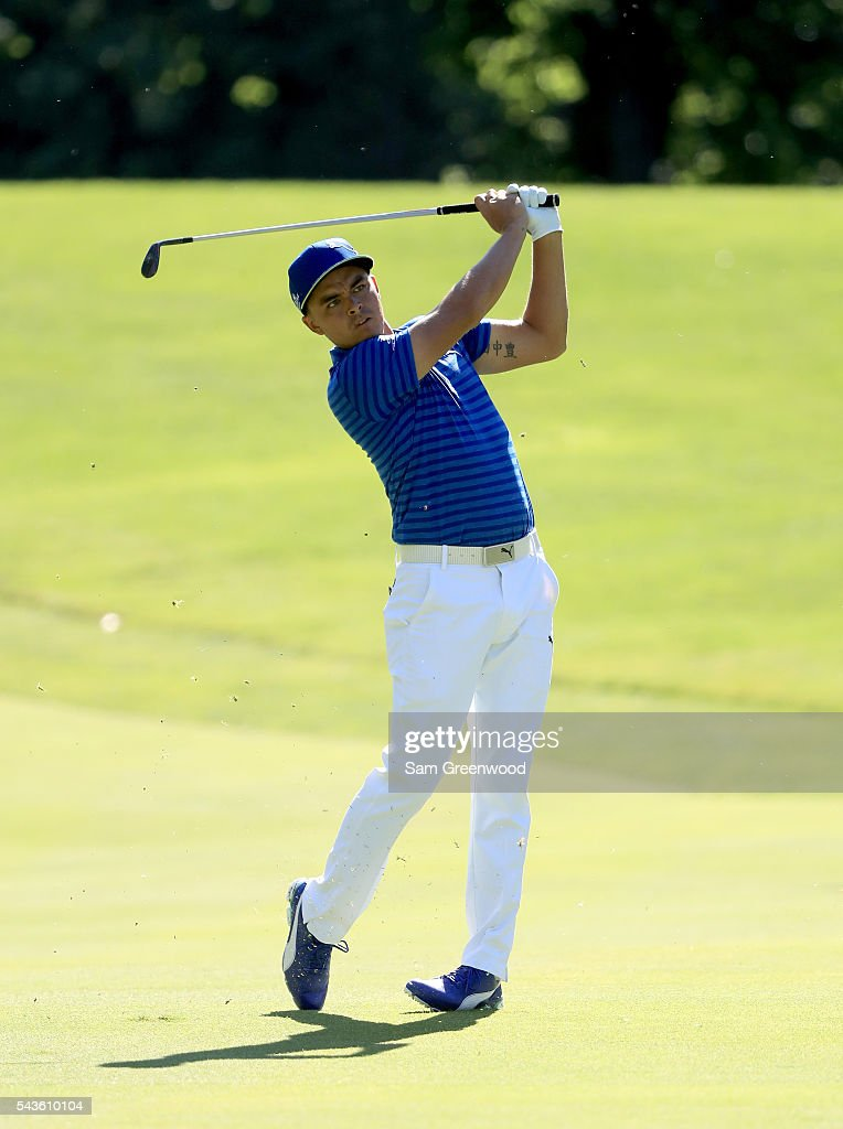 <a gi-track='captionPersonalityLinkClicked' href=/galleries/search?phrase=Rickie+Fowler+-+Golfer&family=editorial&specificpeople=4466576 ng-click='$event.stopPropagation()'>Rickie Fowler</a> plays a shot during a practice round prior to the World Golf Championships-Bridgestone Invitational at Firestone Country Club South course on June 29, 2016 in Akron, Ohio.