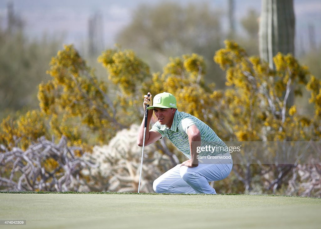 <a gi-track='captionPersonalityLinkClicked' href=/galleries/search?phrase=Rickie+Fowler&family=editorial&specificpeople=4466576 ng-click='$event.stopPropagation()'>Rickie Fowler</a> plays a shot during the third round of the World Golf Championships - Accenture Match Play Championship at The Golf Club at Dove Mountain on February 21, 2014 in Marana, Arizona.