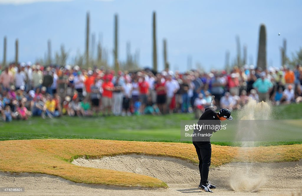 Rickie Fowler plays a shot on the 17th hole during the quarterfinal round of the World Golf Championships - Accenture Match Play Championship at The Golf Club at Dove Mountain on February 22, 2014 in Marana, Arizona.