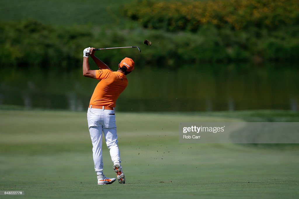 <a gi-track='captionPersonalityLinkClicked' href=/galleries/search?phrase=Rickie+Fowler+-+Golfer&family=editorial&specificpeople=4466576 ng-click='$event.stopPropagation()'>Rickie Fowler</a> plays a shot on the 18th hole during the final round of the Quicken Loans National at Congressional Country Club on June 26, 2016 in Bethesda, Maryland.