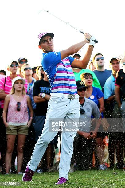 Rickie Fowler plays his second shot on the 16th hole during a playoff in the final round of THE PLAYERS Championship at the TPC Sawgrass Stadium...