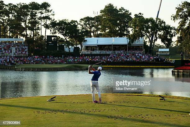 Rickie Fowler plays his shot from the 17th tee during a playoff in the final round of THE PLAYERS Championship at the TPC Sawgrass Stadium course on...