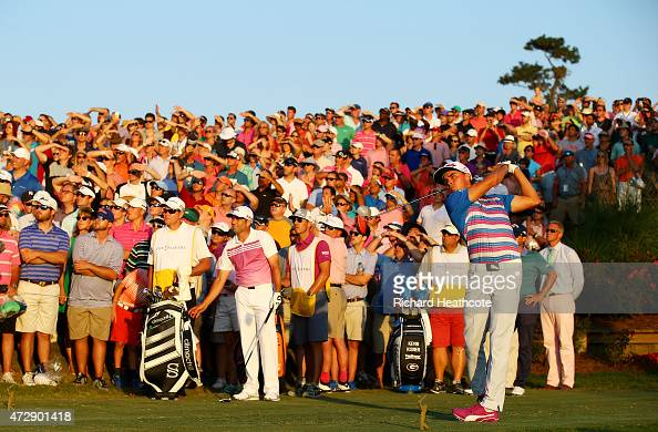 Rickie Fowler plays his shot from the 18th tee during a playoff in the final round of THE PLAYERS Championship at the TPC Sawgrass Stadium course on...
