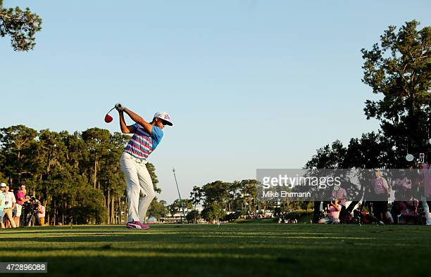 Rickie Fowler plays his shot plays his shot from the 16th tee during a playoff during the final round of THE PLAYERS Championship at the TPC Sawgrass...