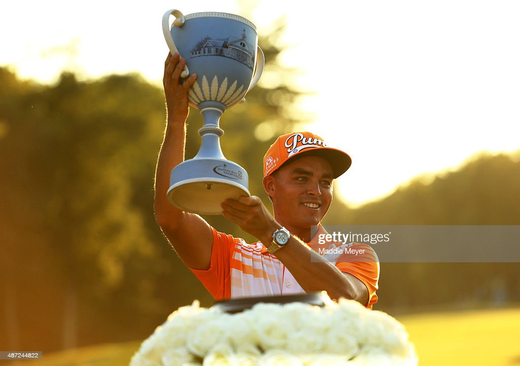 Rickie Fowler raises the winners trophy at the Deutsche Bank Championship at TPC Boston on September 7 2015 in Norton Massachusetts
