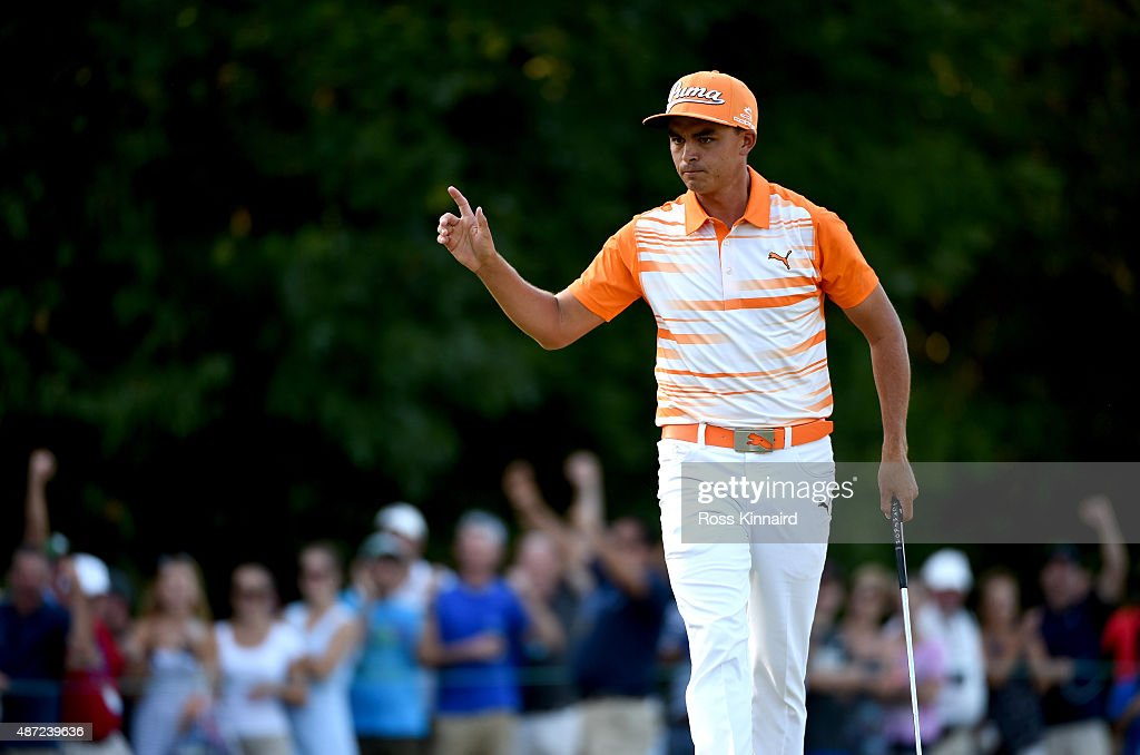 Rickie Fowler reacts after making a birdie putt on the 14th green during the final round of the Deutsche Bank Championship at TPC Boston on September...
