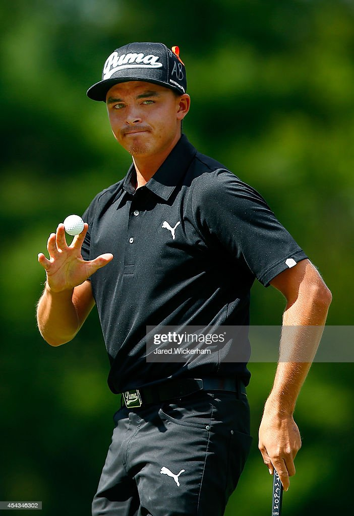 <a gi-track='captionPersonalityLinkClicked' href=/galleries/search?phrase=Rickie+Fowler+-+Golfer&family=editorial&specificpeople=4466576 ng-click='$event.stopPropagation()'>Rickie Fowler</a> reacts after making his putt on the fourth hole during the first round of the Deutsche Bank Championship at the TPC Boston on August 29, 2014 in Norton, Massachusetts.
