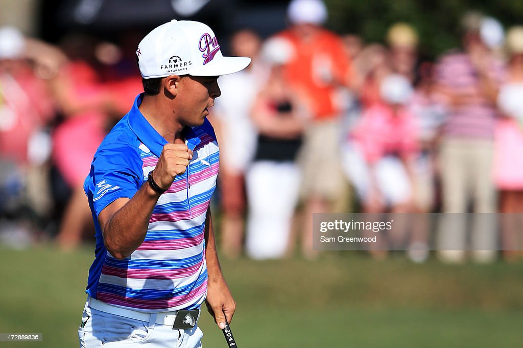 Rickie Fowler reacts after putting for birdie on the 18th green to finish at 12 under par during the final round of THE PLAYERS Championship at the...