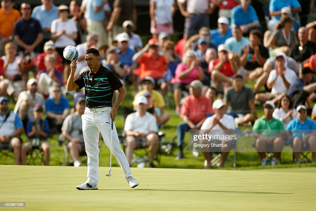 Rickie Fowler reacts after putting on the 18th green during the first round of the World Golf Championships-Bridgestone Invitational at Firestone Country Club South Course on July 31, 2014 in Akron, Ohio.