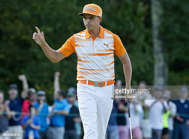 Rickie Fowler reacts after sinking a long birdie putt on the 14th hole during the finalround action of the Deutsche Bank Championship at TPC Boston...