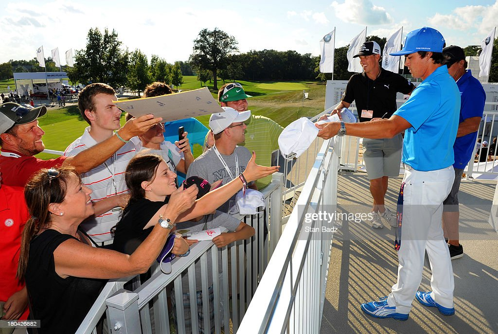 Rickie Fowler signs autographs for fans during the first round of the BMW Championship at Conway Farms Golf Club on September 12, 2013 in Lake Forest, Illinois.