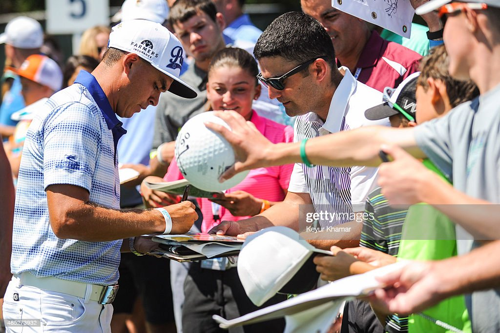 Rickie Fowler signs autographs for fans off the fifth hole green during practice for The Barclays at Plainfield Country Club on August 26 2015 in...