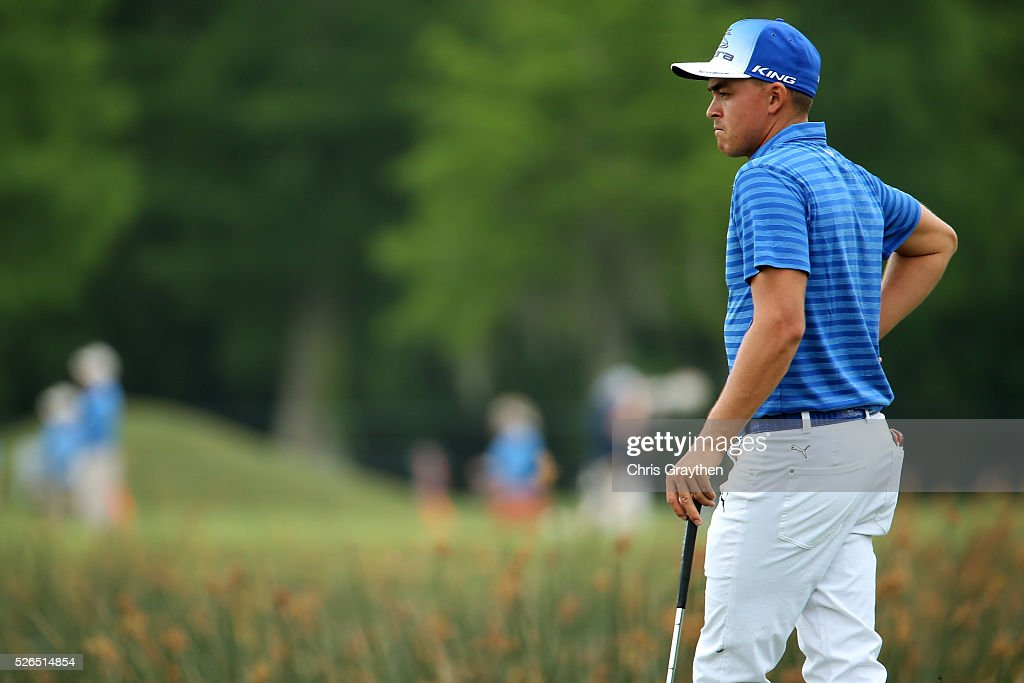 Rickie Fowler stands on the 18th green during the continuaiton of the second round of the Zurich Classic of New Orleans at TPC Louisiana on April 30, 2016 in Avondale, Louisiana.