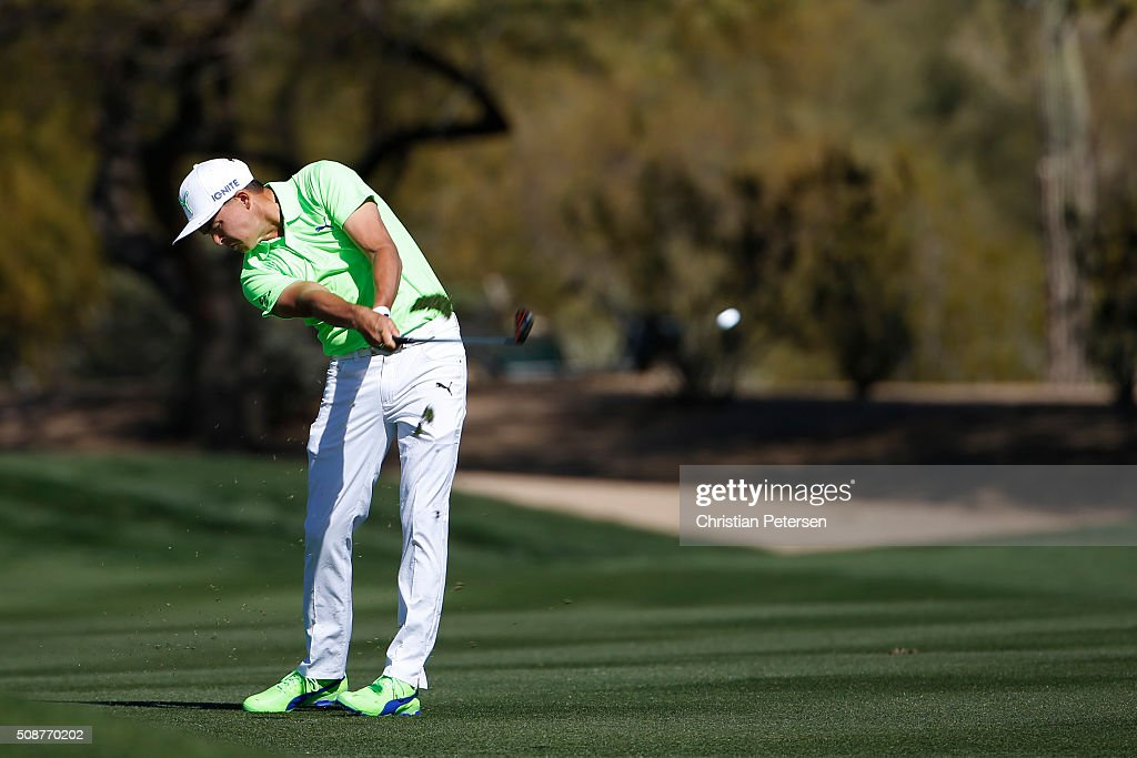 Rickie Fowler takes his second shot on the second hole during the third round of the Waste Management Phoenix Open at TPC Scottsdale on February 6, 2016 in Scottsdale, Arizona.