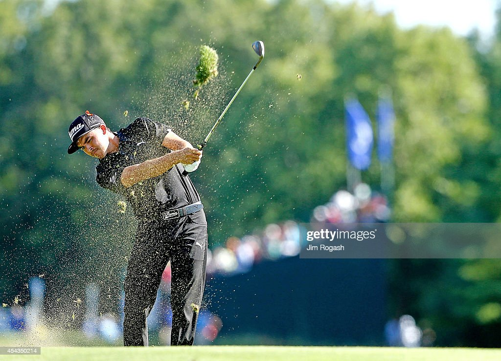 <a gi-track='captionPersonalityLinkClicked' href=/galleries/search?phrase=Rickie+Fowler+-+Golfer&family=editorial&specificpeople=4466576 ng-click='$event.stopPropagation()'>Rickie Fowler</a> takes his shot on the 10th hole hole during the first round of the Deutsche Bank Championship at the TPC Boston on August 29, 2014 in Norton, Massachusetts.