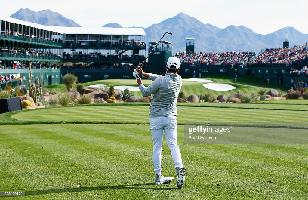 Rickie Fowler tees off on the 16th hole during the first round of the Waste Management Phoenix Open at TPC Scottsdale on February 4 2016 in...