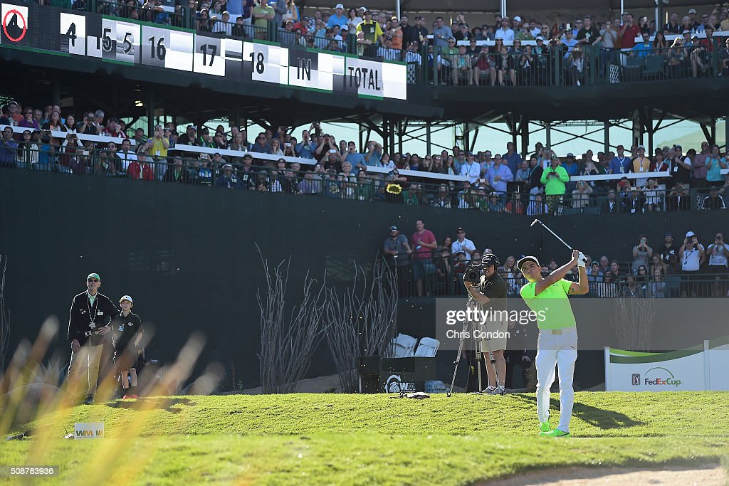 <a gi-track='captionPersonalityLinkClicked' href=/galleries/search?phrase=Rickie+Fowler&family=editorial&specificpeople=4466576 ng-click='$event.stopPropagation()'>Rickie Fowler</a> tees off on the 16th hole during the third round of the Waste Management Phoenix Open, at TPC Scottsdale on February 6, 2016 in Scottsdale, Arizona.