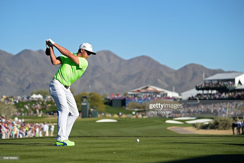 <a gi-track='captionPersonalityLinkClicked' href=/galleries/search?phrase=Rickie+Fowler&family=editorial&specificpeople=4466576 ng-click='$event.stopPropagation()'>Rickie Fowler</a> tees off on the 17th hole during the third round of the Waste Management Phoenix Open, at TPC Scottsdale on February 6, 2016 in Scottsdale, Arizona.