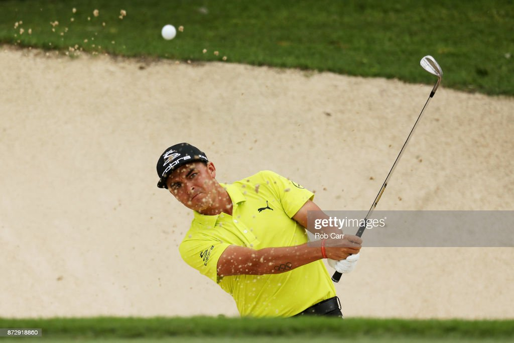 Rickie Fowler the United States plays a shot from a bunker on the 18th hole during the continuation of the second round of the OHL Classic at Mayakoba on November 11, 2017 in Playa del Carmen, Mexico.