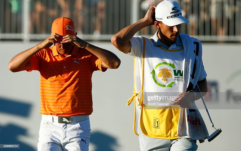 <a gi-track='captionPersonalityLinkClicked' href=/galleries/search?phrase=Rickie+Fowler&family=editorial&specificpeople=4466576 ng-click='$event.stopPropagation()'>Rickie Fowler</a> walks off on the 17th hole after being defeated by <a gi-track='captionPersonalityLinkClicked' href=/galleries/search?phrase=Hideki+Matsuyama&family=editorial&specificpeople=5566852 ng-click='$event.stopPropagation()'>Hideki Matsuyama</a> of Japan on the fourth playoff hole during the final round of the Waste Management Phoenix Open at TPC Scottsdale on February 7, 2016 in Scottsdale, Arizona.