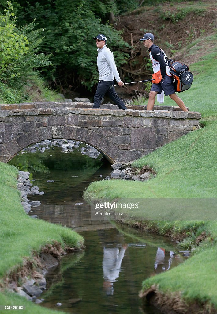 Rickie Fowler walks over the bridge on the 13th hole during the first round of the 2016 Wells Fargo Championship at Quail Hollow Club on May 5, 2016 in Charlotte, North Carolina.