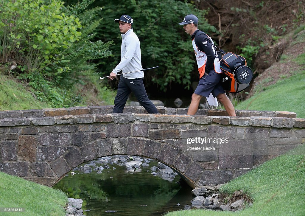 <a gi-track='captionPersonalityLinkClicked' href=/galleries/search?phrase=Rickie+Fowler&family=editorial&specificpeople=4466576 ng-click='$event.stopPropagation()'>Rickie Fowler</a> walks over the bridge on the 13th hole during the first round of the 2016 Wells Fargo Championship at Quail Hollow Club on May 5, 2016 in Charlotte, North Carolina.