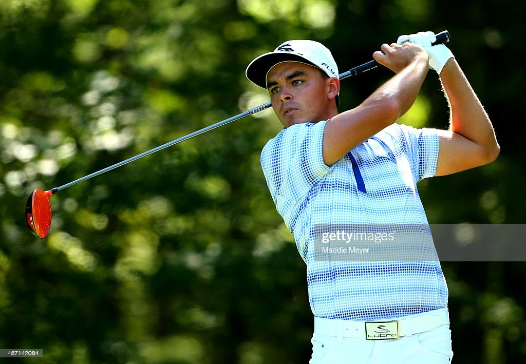 Rickie Fowler watches his tee shot from on the fifth hole during round three of the Deutsche Bank Championship at TPC Boston on September 6 2015 in...