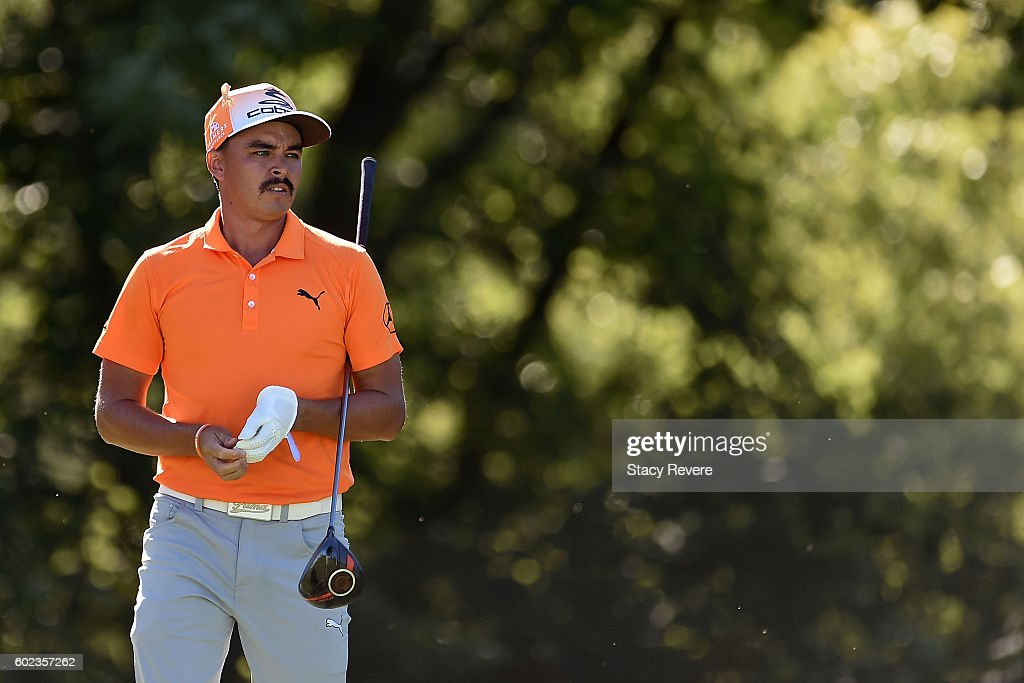 Rickie Fowler watches his tee shot on the ninth hole during the final round of the BMW Championship at Crooked Stick Golf Club on September 11, 2016 in Carmel, Indiana.