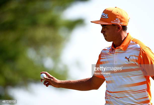 Rickie Fowler waves to fans on the seventh green during the final round of the Deutsche Bank Championship at TPC Boston on September 7 2015 in Norton...
