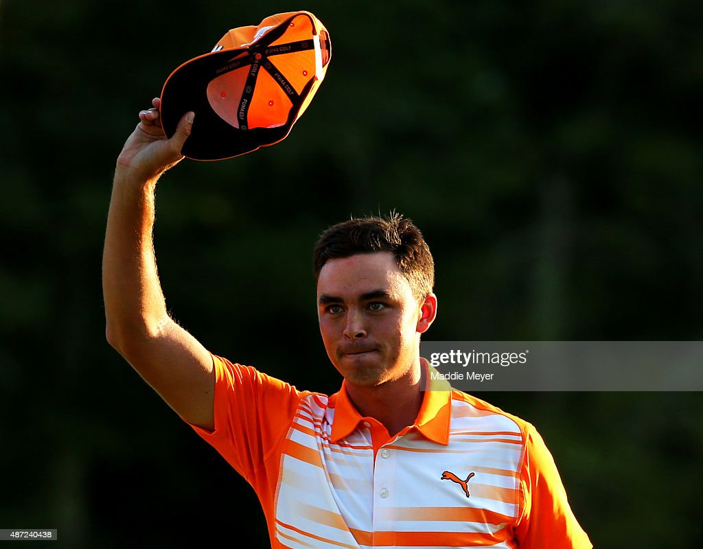 Rickie Fowler waves to the crowd after winning the Deutsche Bank Championship by onestroke over Henrik Stenson of Sweden at TPC Boston on September 7...