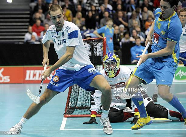 Rickie Hyvarinen of team Finland vies for the ball with Sweden's goalie Patrik Jansson and defender Mathias Larsson during the World Floorball...