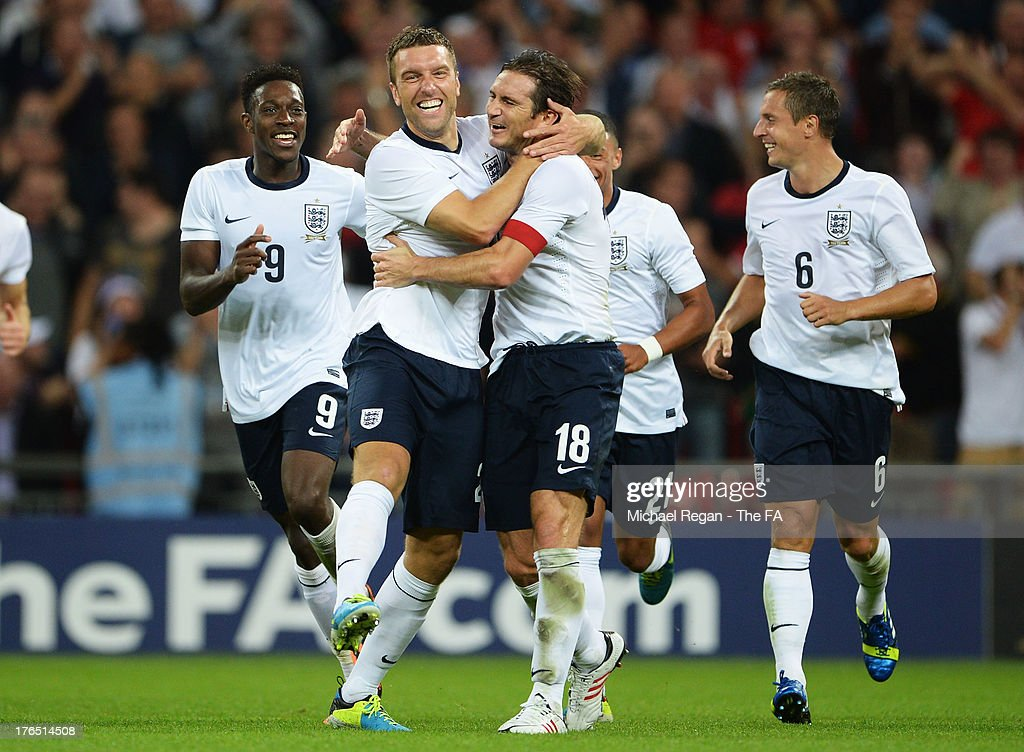<a gi-track='captionPersonalityLinkClicked' href=/galleries/search?phrase=Rickie+Lambert&family=editorial&specificpeople=4124959 ng-click='$event.stopPropagation()'>Rickie Lambert</a> of England (second left) celebrates after scoring his side's third goal with team mate <a gi-track='captionPersonalityLinkClicked' href=/galleries/search?phrase=Frank+Lampard+-+Born+1978&family=editorial&specificpeople=11497645 ng-click='$event.stopPropagation()'>Frank Lampard</a> during the International Friendly match between England and Scotland at Wembley Stadium on August 14, 2013 in London, England.