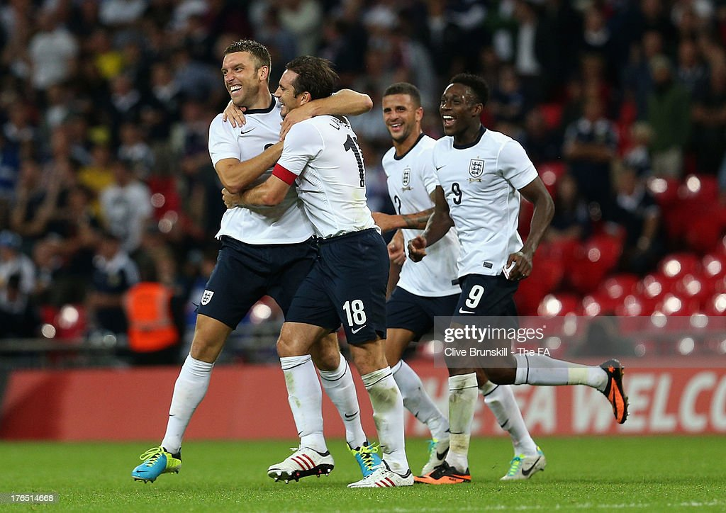 <a gi-track='captionPersonalityLinkClicked' href=/galleries/search?phrase=Rickie+Lambert&family=editorial&specificpeople=4124959 ng-click='$event.stopPropagation()'>Rickie Lambert</a> of England (L) celebrates after scoring his side's third goal with team mate <a gi-track='captionPersonalityLinkClicked' href=/galleries/search?phrase=Frank+Lampard+-+Born+1978&family=editorial&specificpeople=11497645 ng-click='$event.stopPropagation()'>Frank Lampard</a> during the International Friendly match between England and Scotland at Wembley Stadium on August 14, 2013 in London, England.