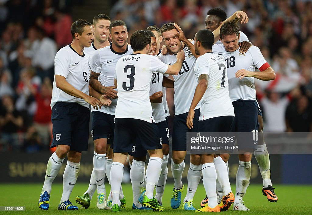 <a gi-track='captionPersonalityLinkClicked' href=/galleries/search?phrase=Rickie+Lambert&family=editorial&specificpeople=4124959 ng-click='$event.stopPropagation()'>Rickie Lambert</a> of England (20) celebrates after scoring his side's third goal with team mates during the International Friendly match between England and Scotland at Wembley Stadium on August 14, 2013 in London, England.