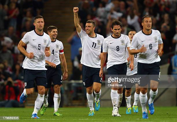 Rickie Lambert of England celebrates scoring their second goal during the FIFA 2014 World Cup Qualifying Group H match between England and Moldova at...
