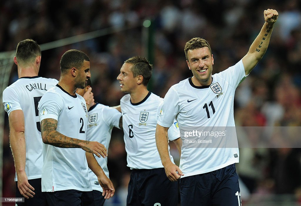 <a gi-track='captionPersonalityLinkClicked' href=/galleries/search?phrase=Rickie+Lambert&family=editorial&specificpeople=4124959 ng-click='$event.stopPropagation()'>Rickie Lambert</a> of England celebrates scoring their second goal during the FIFA 2014 World Cup Qualifying Group H match between England and Moldova at Wembley Stadium on September 6, 2013 in London, England.