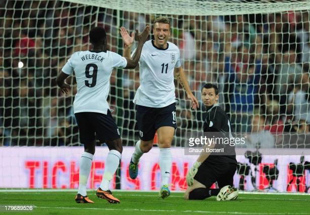 Rickie Lambert of England celebrates scoring their second goal with Rickie Lambert of England during the FIFA 2014 World Cup Qualifying Group H match...