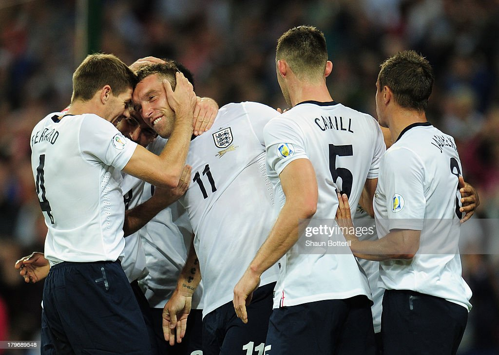 <a gi-track='captionPersonalityLinkClicked' href=/galleries/search?phrase=Rickie+Lambert&family=editorial&specificpeople=4124959 ng-click='$event.stopPropagation()'>Rickie Lambert</a> of England celebrates scoring their second goal with <a gi-track='captionPersonalityLinkClicked' href=/galleries/search?phrase=Steven+Gerrard&family=editorial&specificpeople=202052 ng-click='$event.stopPropagation()'>Steven Gerrard</a> of England during the FIFA 2014 World Cup Qualifying Group H match between England and Moldova at Wembley Stadium on September 6, 2013 in London, England.