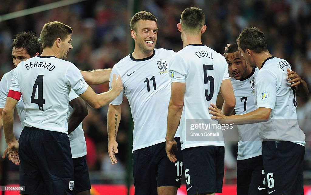 Rickie Lambert of England celebrates scoring their second goal with team mates during the FIFA 2014 World Cup Qualifying Group H match between England and Moldova at Wembley Stadium on September 6, 2013 in London, England.