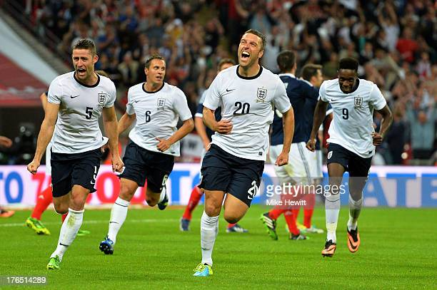 Rickie Lambert of England celebrates with teammates Gary Cahill of England and Danny Welbeck of England after scoring a goal during the International...