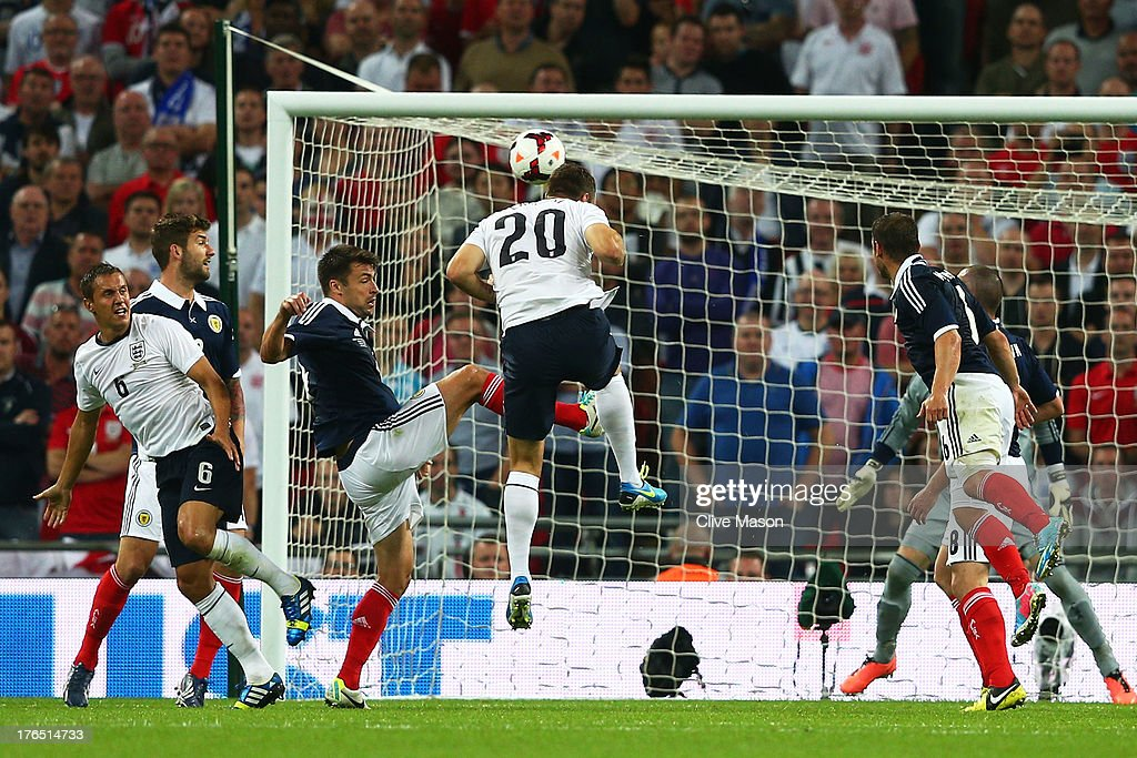 <a gi-track='captionPersonalityLinkClicked' href=/galleries/search?phrase=Rickie+Lambert&family=editorial&specificpeople=4124959 ng-click='$event.stopPropagation()'>Rickie Lambert</a> of England (#20) scores a goal during the International Friendly match between England and Scotland at Wembley Stadium on August 14, 2013 in London, England.