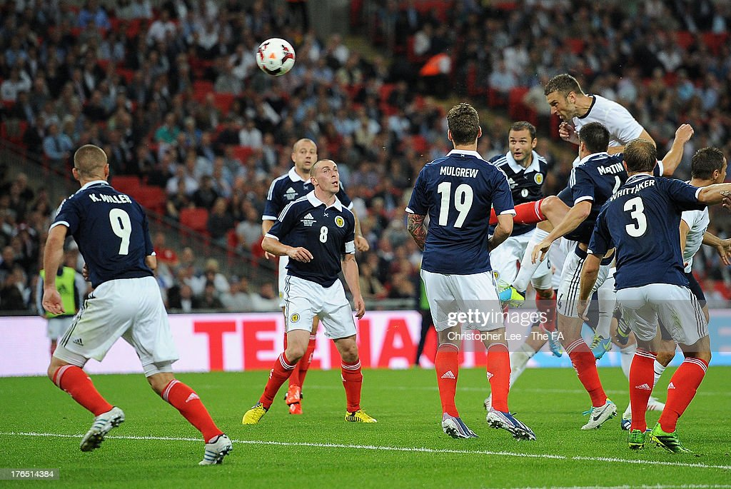 <a gi-track='captionPersonalityLinkClicked' href=/galleries/search?phrase=Rickie+Lambert&family=editorial&specificpeople=4124959 ng-click='$event.stopPropagation()'>Rickie Lambert</a> of England scores his side's third goal during the International Friendly match between England and Scotland at Wembley Stadium on August 14, 2013 in London, England.