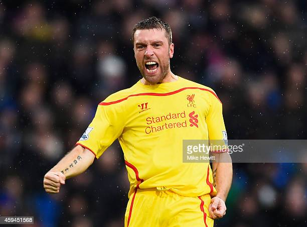 Rickie Lambert of Liverpool celebrates scoring the opening goal during the Barclays Premier League match between Crystal Palace and Liverpool at...