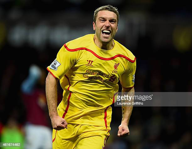 Rickie Lambert of Liverpool celebrates scoring their second goal during the Barclays Premier League match between Aston Villa and Liverpool at Villa...