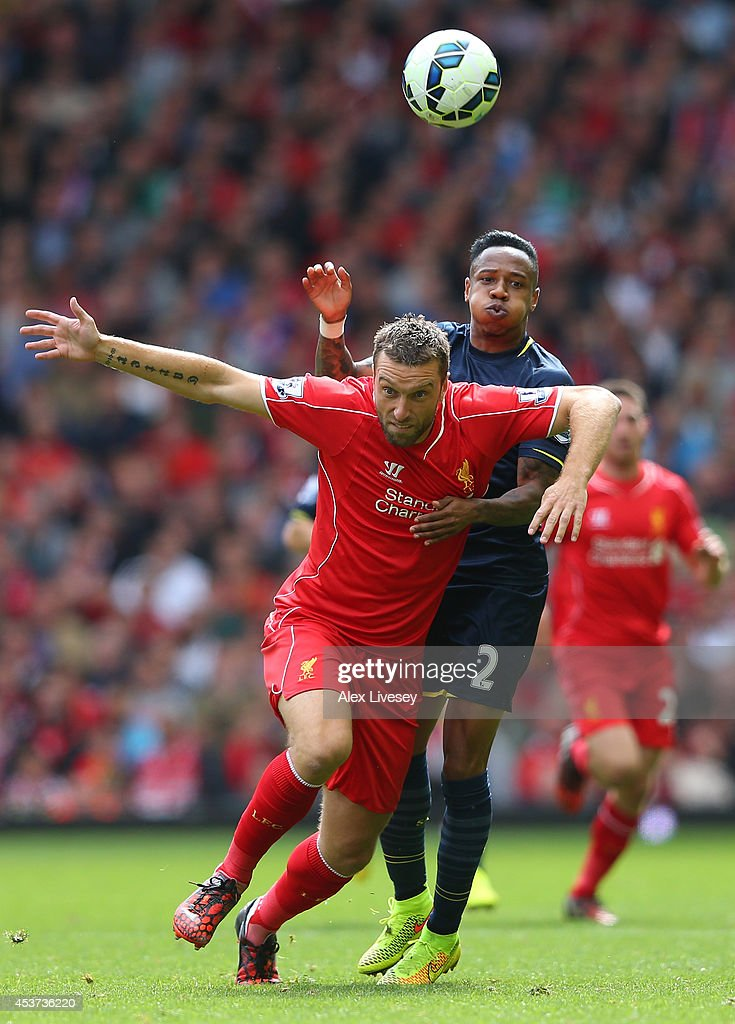 <a gi-track='captionPersonalityLinkClicked' href=/galleries/search?phrase=Rickie+Lambert&family=editorial&specificpeople=4124959 ng-click='$event.stopPropagation()'>Rickie Lambert</a> of Liverpool holds off a challenge from <a gi-track='captionPersonalityLinkClicked' href=/galleries/search?phrase=Nathaniel+Clyne+-+Soccer+Player&family=editorial&specificpeople=5738873 ng-click='$event.stopPropagation()'>Nathaniel Clyne</a> of Southampton during the Barclays Premier League match between Liverpool and Southampton at Anfield on August 17, 2014 in Liverpool, England.