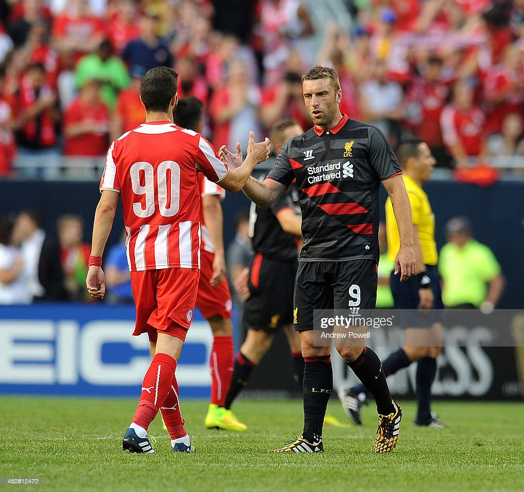 <a gi-track='captionPersonalityLinkClicked' href=/galleries/search?phrase=Rickie+Lambert&family=editorial&specificpeople=4124959 ng-click='$event.stopPropagation()'>Rickie Lambert</a> of Liverpool shakes hands with <a gi-track='captionPersonalityLinkClicked' href=/galleries/search?phrase=Sambou+Yatabare&family=editorial&specificpeople=5747366 ng-click='$event.stopPropagation()'>Sambou Yatabare</a> of Olympiacos during the International Champions Cup match between Liverpool and Olympiacos at Soldier Field on July 27, 2014 in Chicago, Illinois.